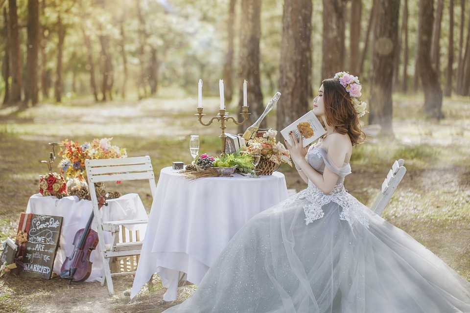Bride sitting on a chair in the forest