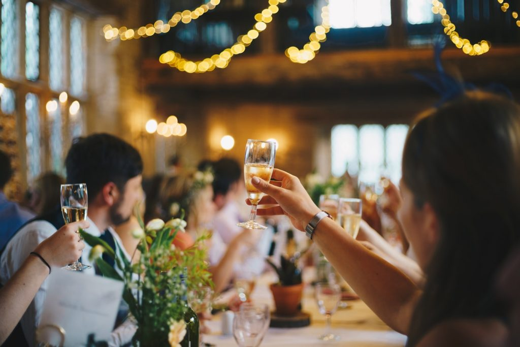 Girl holding Champagne in wedding part