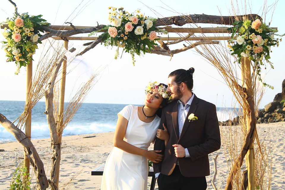 Couple standing at their wedding venue by the sea