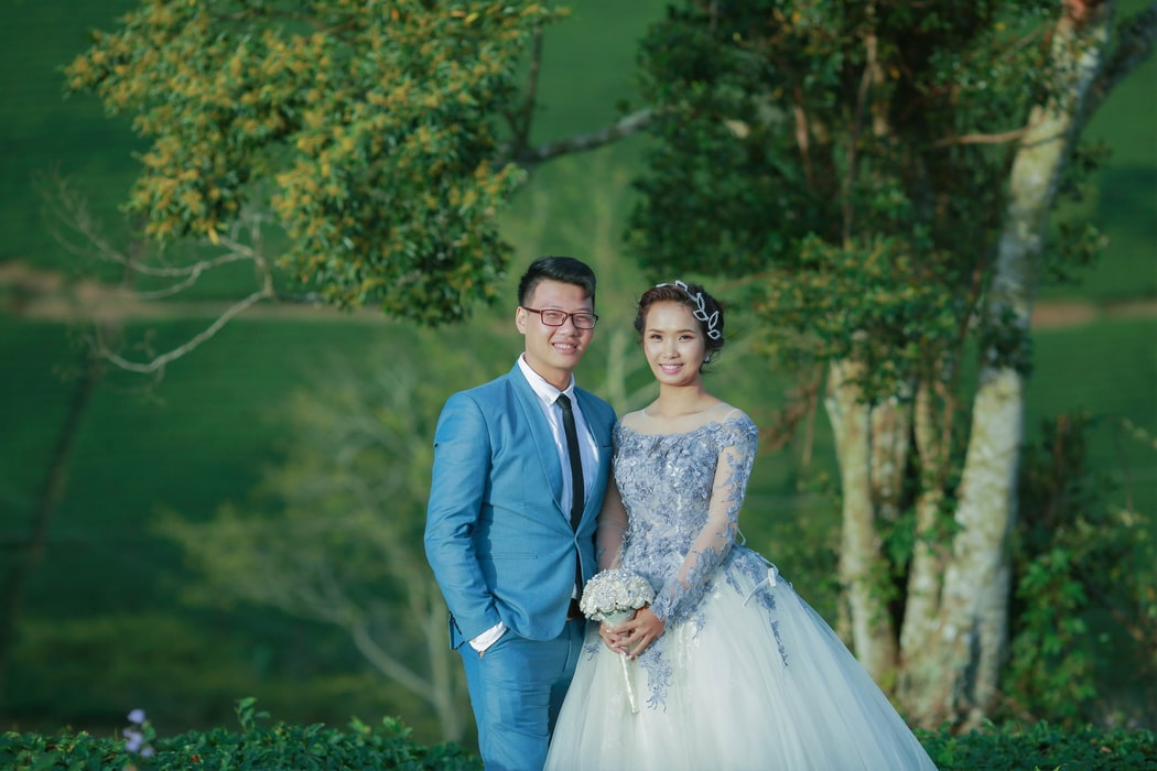 Bride wearing colored wedding gown