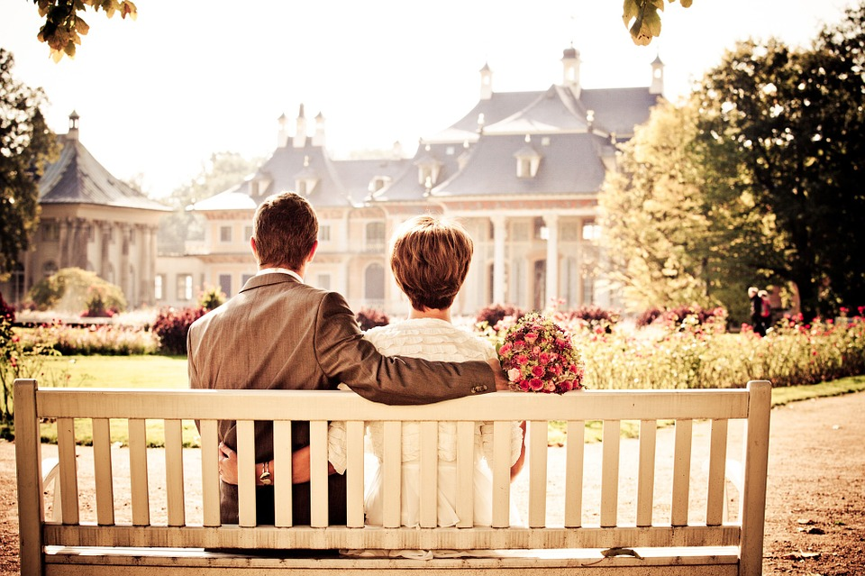 Couple sitting on a bench at their wedding venue