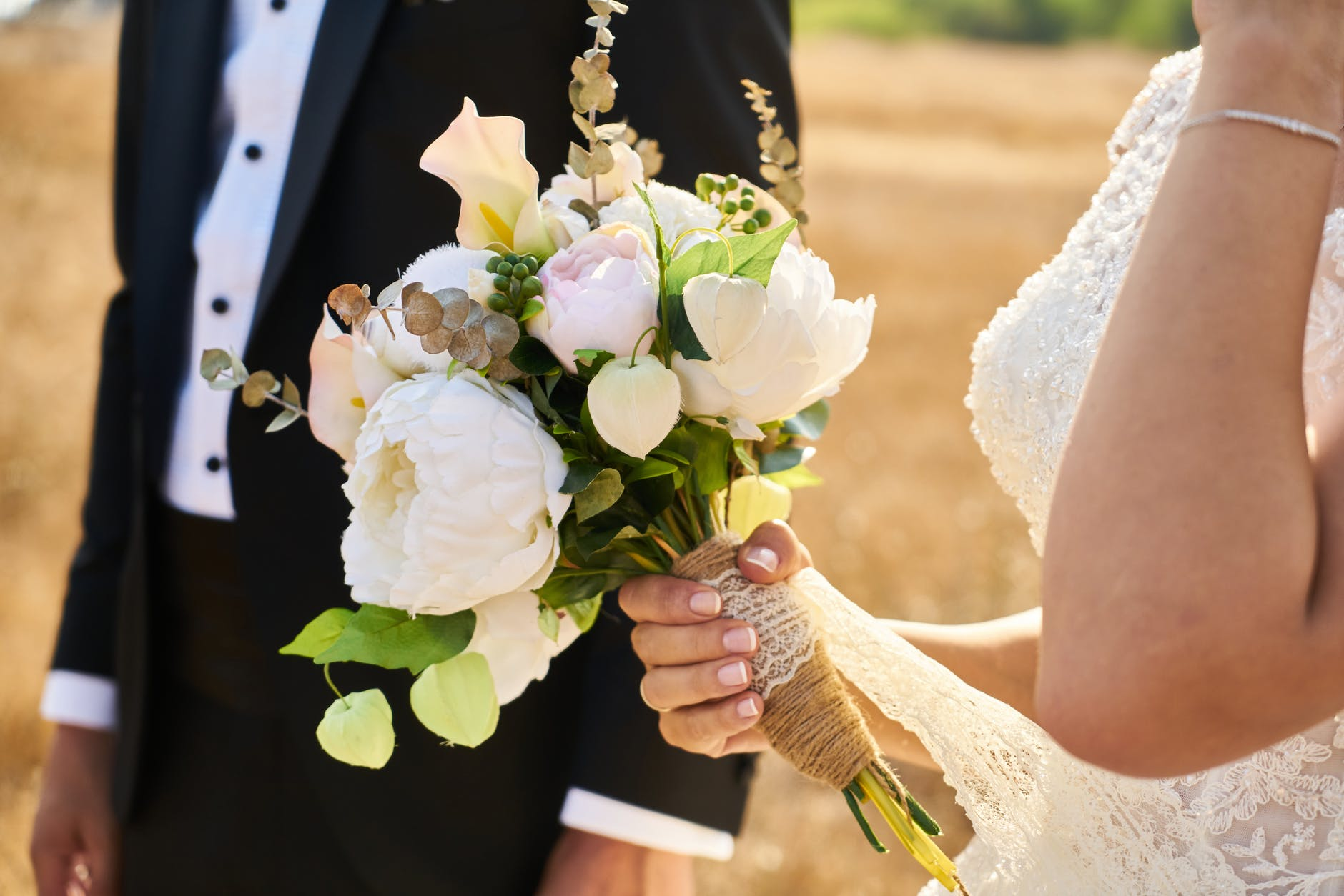 Bride holding hand tied bouquet