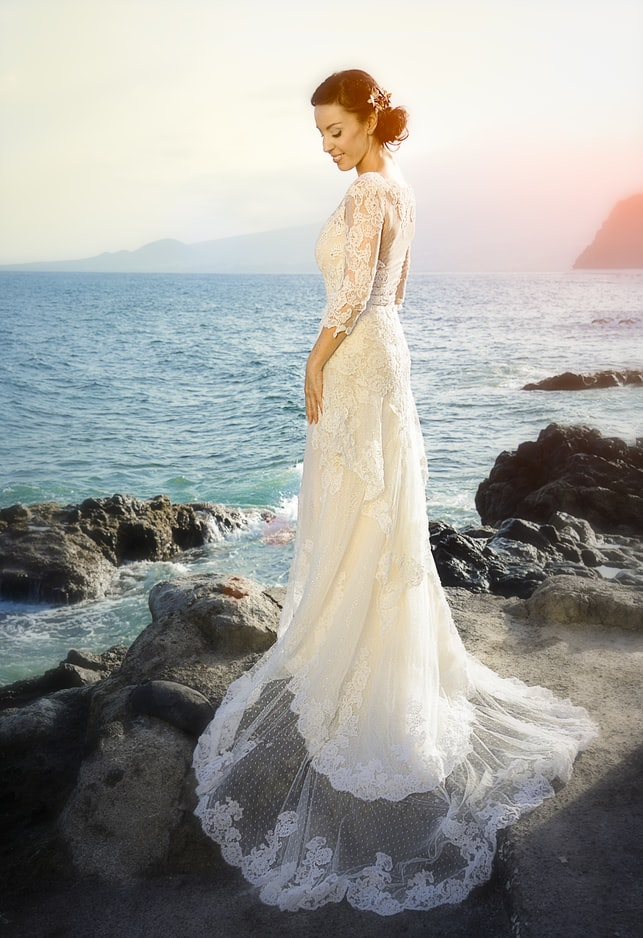 Bride wearing long sleeved wedding dress