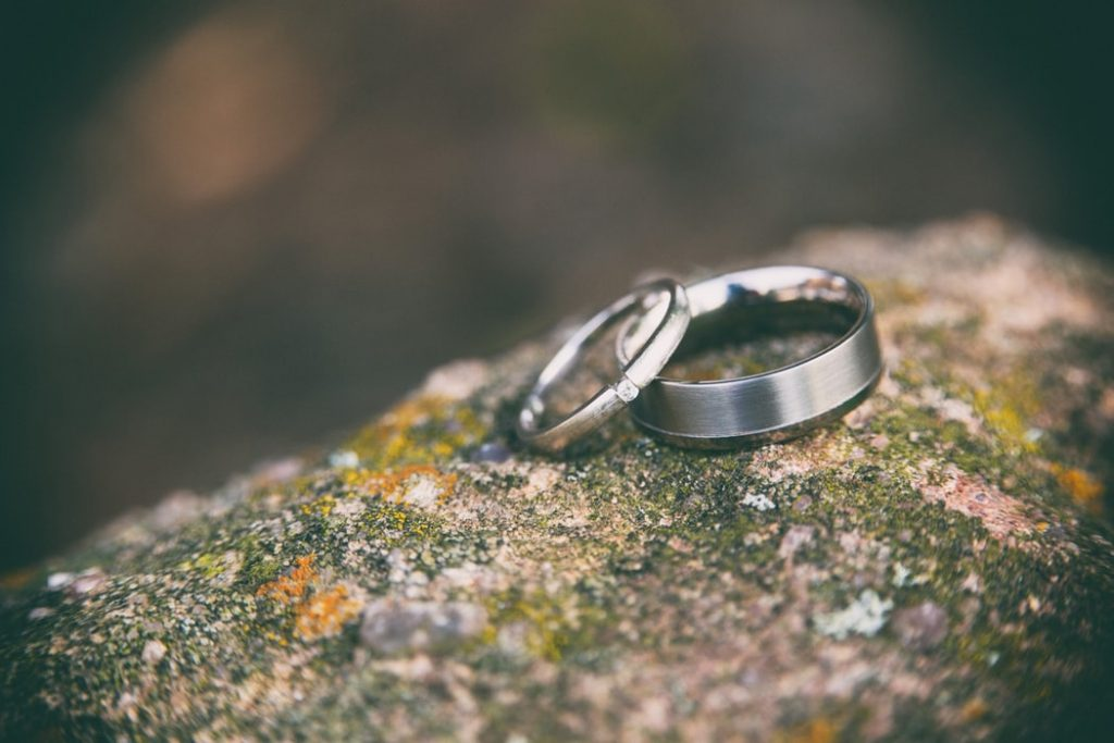 Two wedding rings on a stone