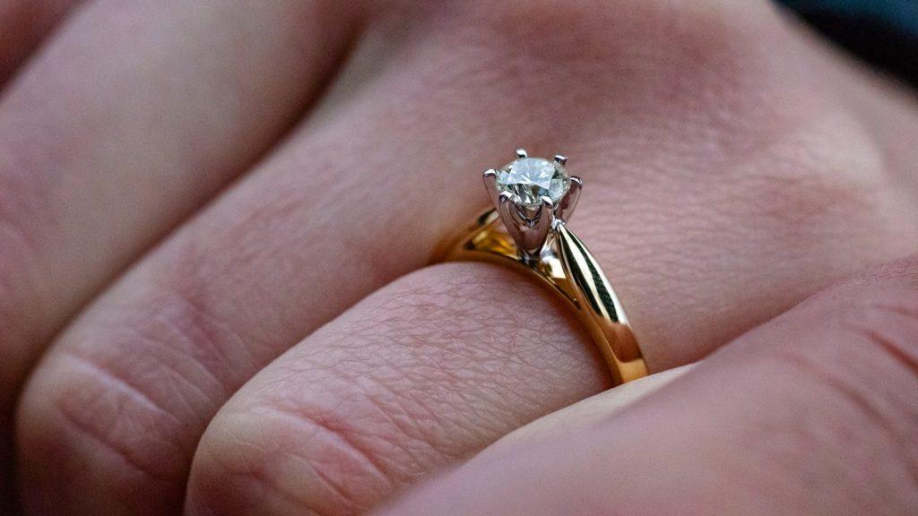 Moissanite engagement ring on bride's finger
