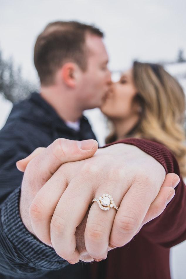 Couple holding hand girl wearing moissanite ring