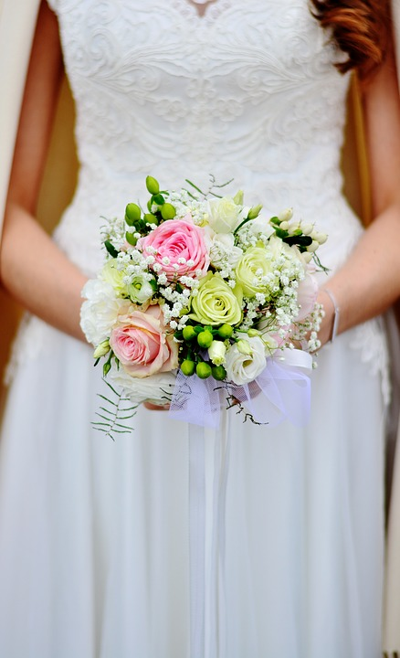 Bride holding nose gay flowers
