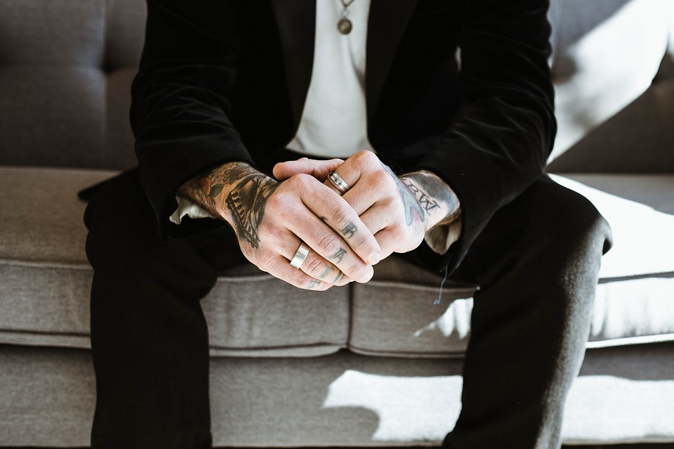 Groom wearing wedding band