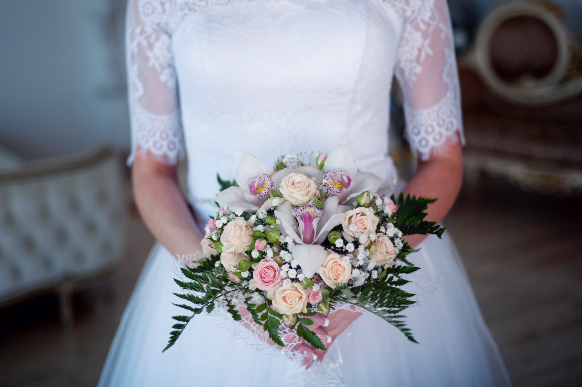 Bride holding round posy bouquet