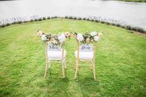 2 chairs on grass for wedding day