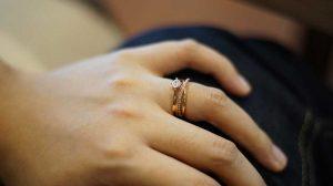 Stackable wedding ring on Bride's finger
