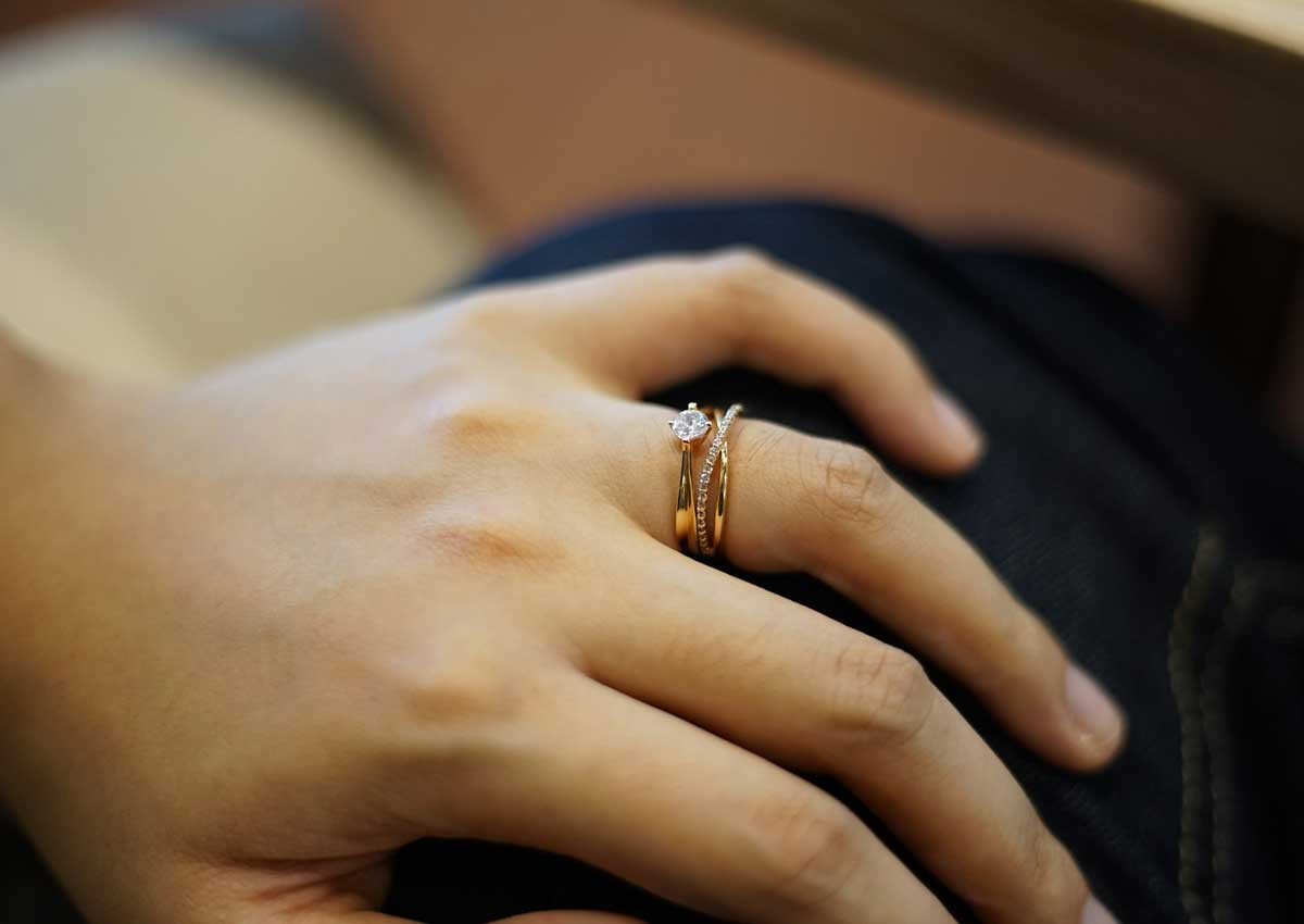 Stackable wedding ring on Bride's finger