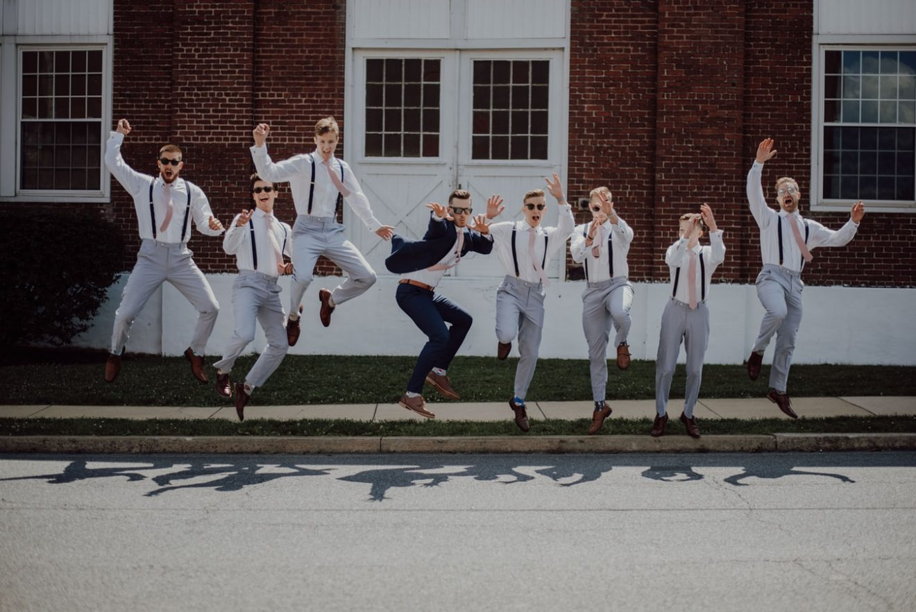 groomsmen and groom jumping for a photos hoot