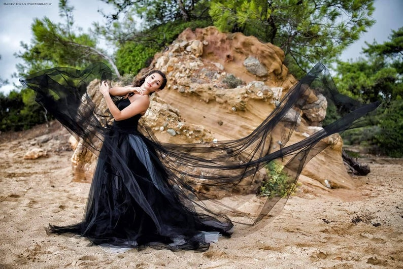 Bride wearing black wedding dress
