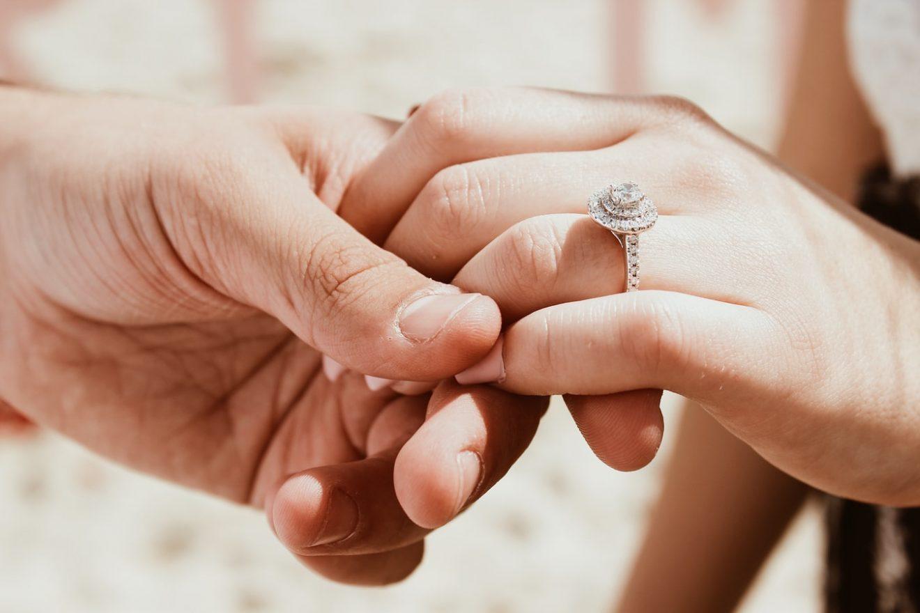 Bride wearing rose cut diamond engagement ring