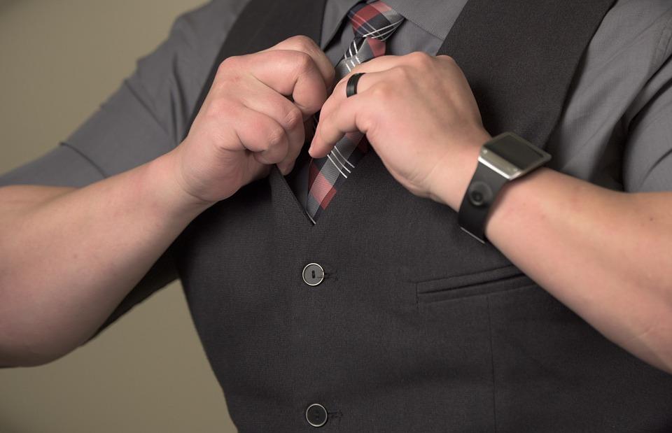 Groom wearing wedding ring