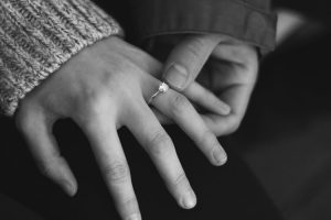 Woman's hand wearing moissanite engagement ring