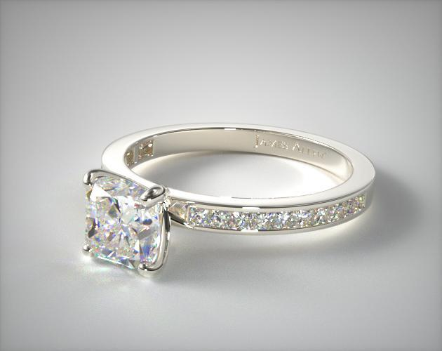 Cushion cut engagement ring in white gold close up