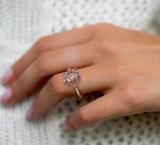 Close up engagement ring on finger bride