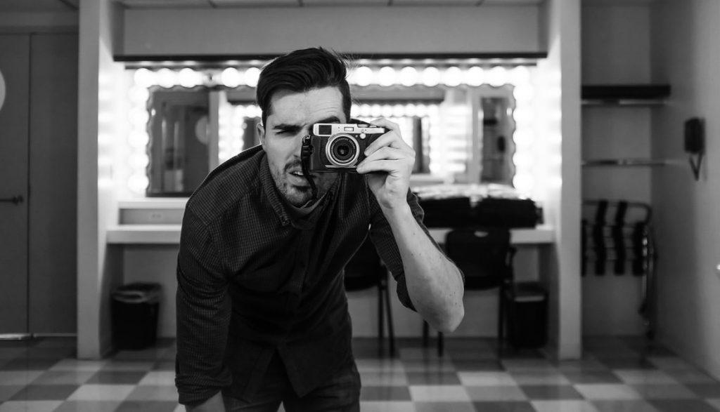 Man taking photo using a camera