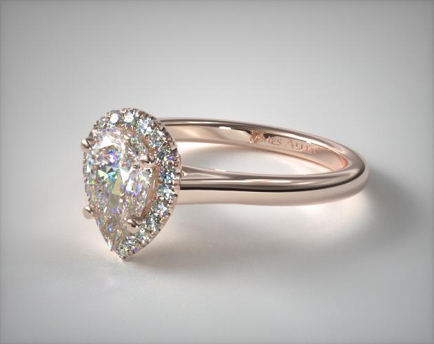 Halo setting pear shape diamond engagement ring