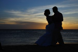 Bride and groom in illustrative wedding photography style in sunset
