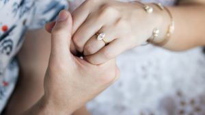 Bride wearing marquise cut engagement ring