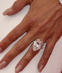 Pear shape engagement ring on fonger
