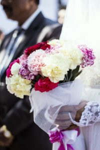 Bride holding peonies large bouquet