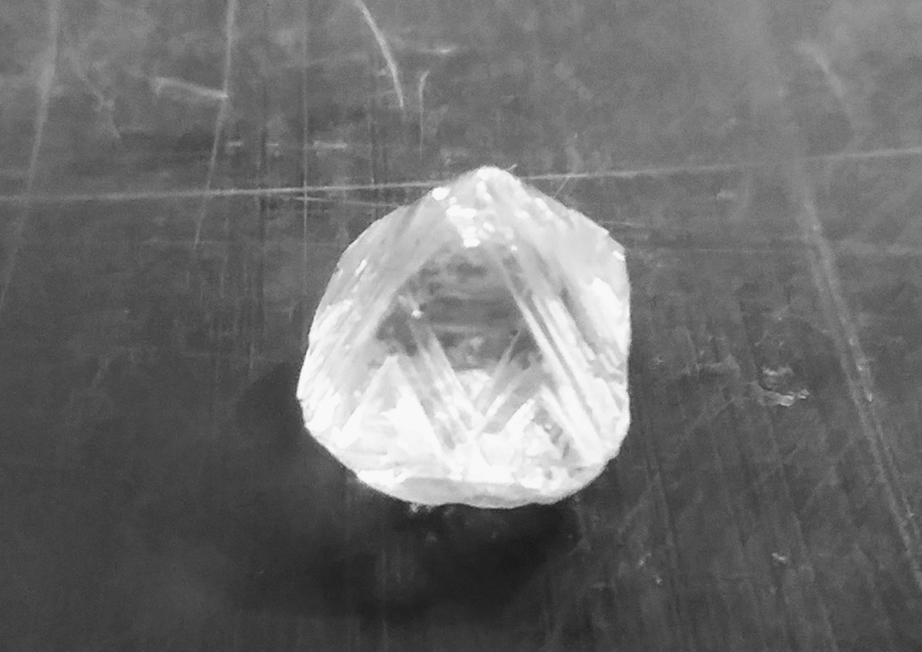Raw diamond on black background