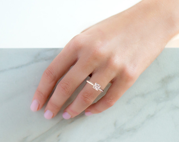 Princess cut engagement ring on girl's finger
