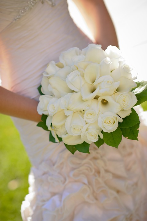 White roses in bouquet for wedding day