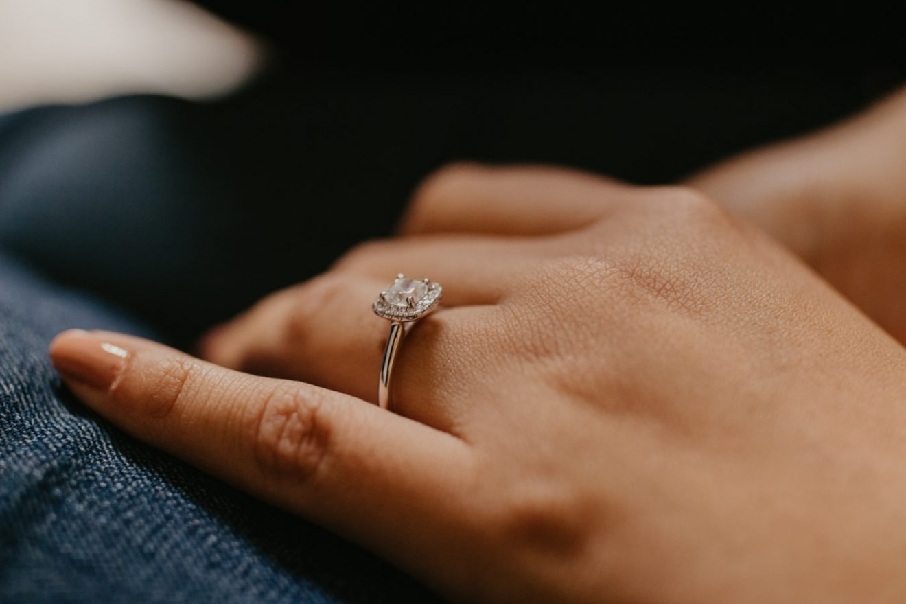 Square shape diamond engagement ring on girl's finger
