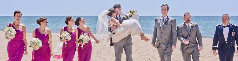 Bride and groom + bridesmaids + groomsmen being photographed