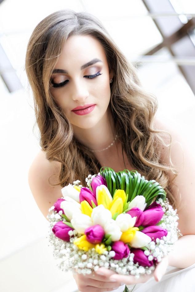 Bride holding tulips wedding bouquet