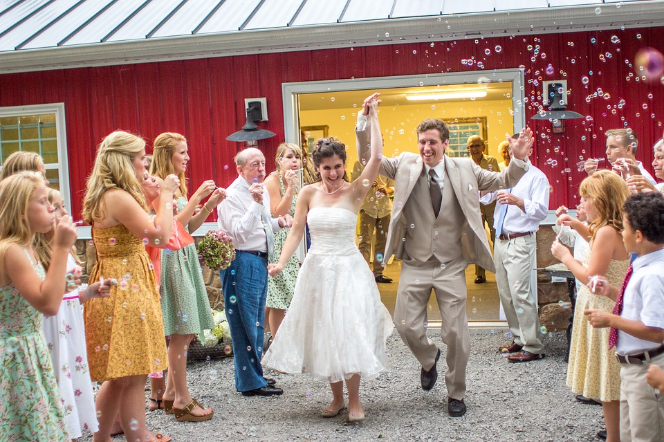 Couples exiting with bubbles in their wedding day