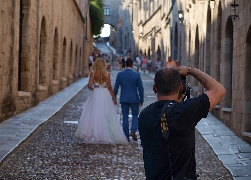 Bride and groom being photographed by a professional photographer