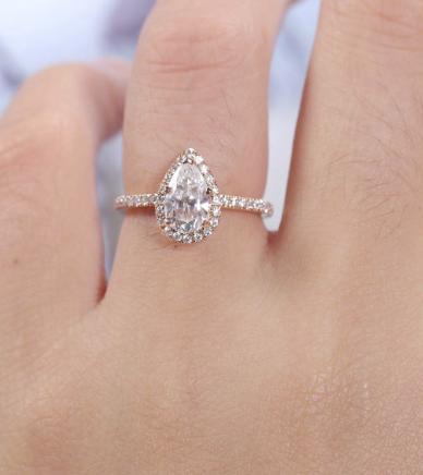 Pear shape engagement ring on finger
