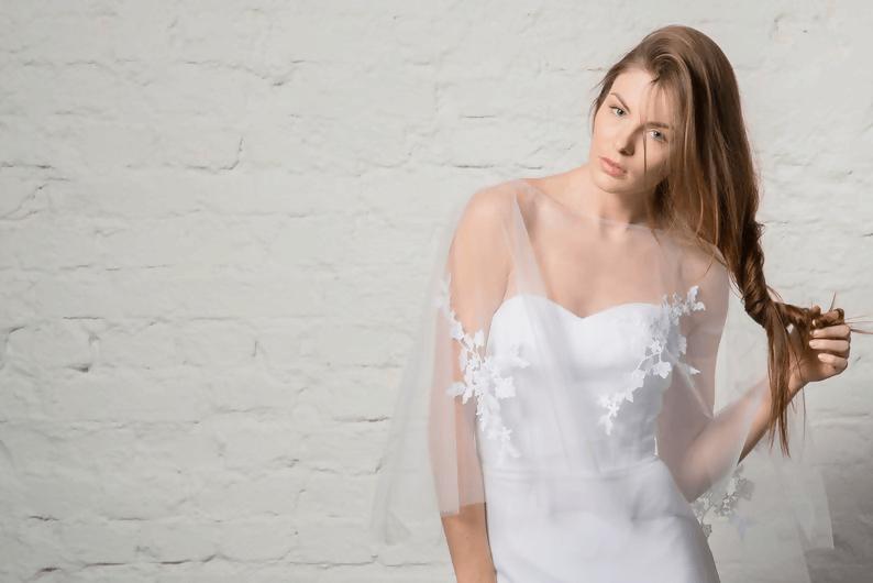 Bridal poncho by Letthe Bride