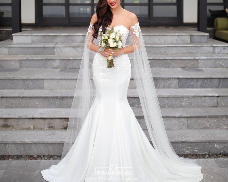 Bride wearing white arm veil