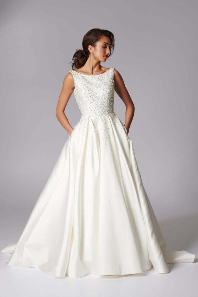 Bride wearing white bateau neckline wedding dress