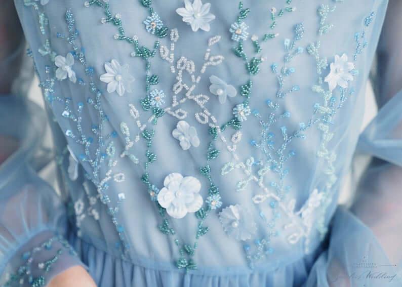 beaded flowers on wedding dress close up