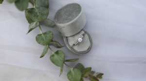 Round shape diamond engagement ring in a box
