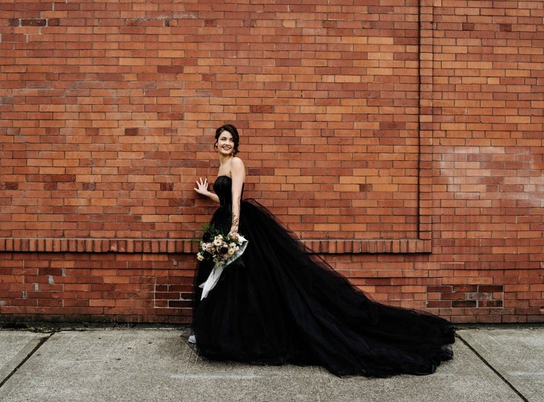 Bride wearing black wedding dress