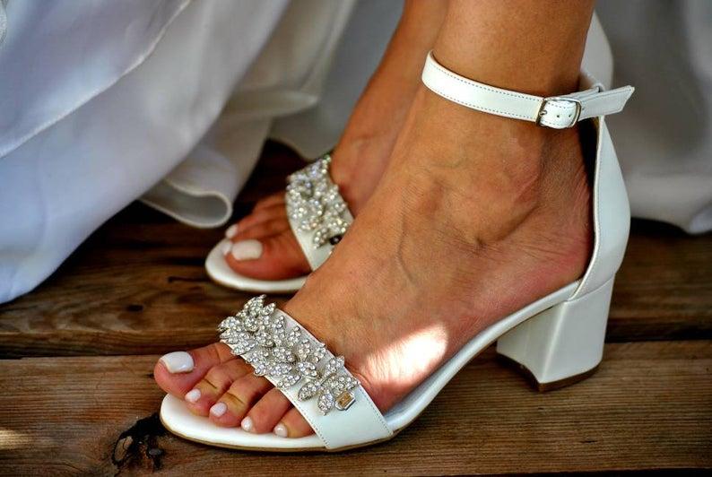 Bride wearing white block heels