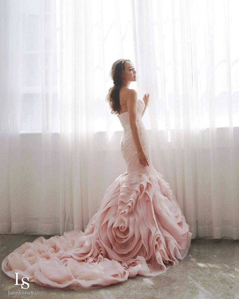 Girl wearing blush rose mermaid wedding dress