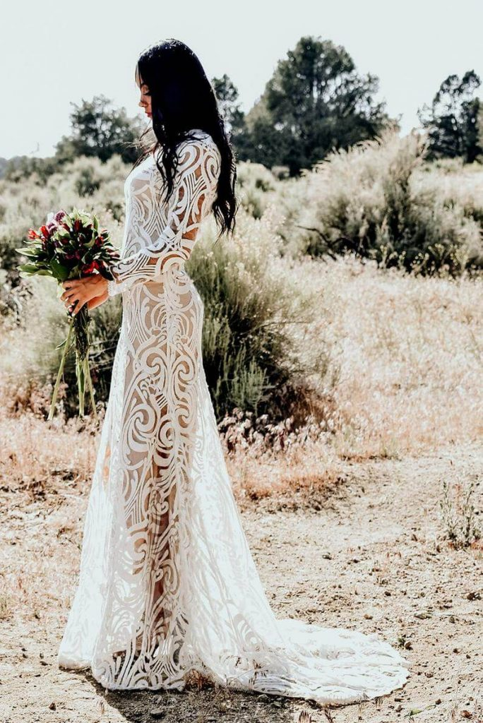 Bohemian lace dress worn by bride