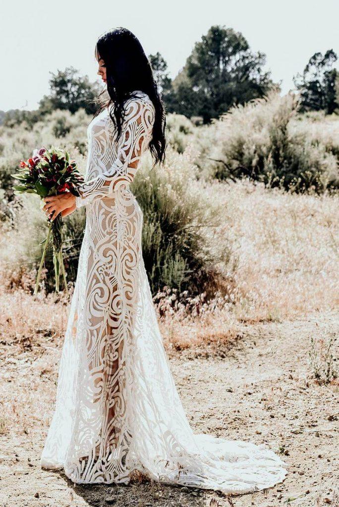 Bohemian lace dress worn by bride
