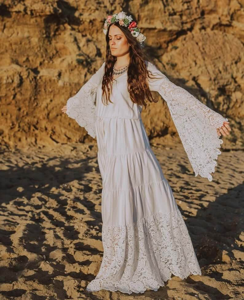Bride wearing boho long sleeve dress