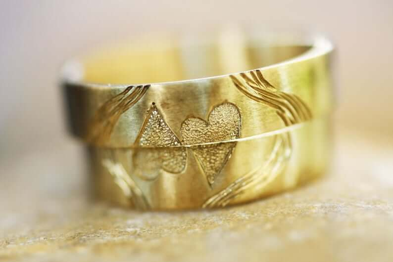 Brass wedding bands with hearts